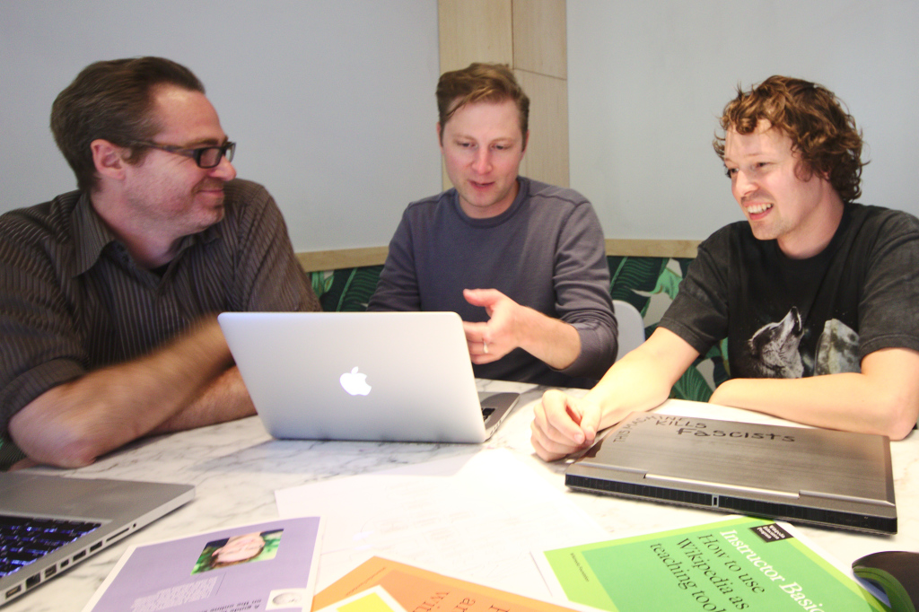 Sage Ross (on the right) working with developers from WINTR out of their office in Seattle.