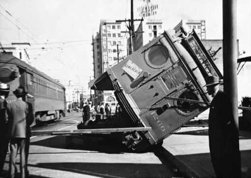 """Turned over trolly"" by University of California - Sunshine is Never Enough by John Laslett. Licensed under Public domain in the United States"">PD-US via Wikipedia."