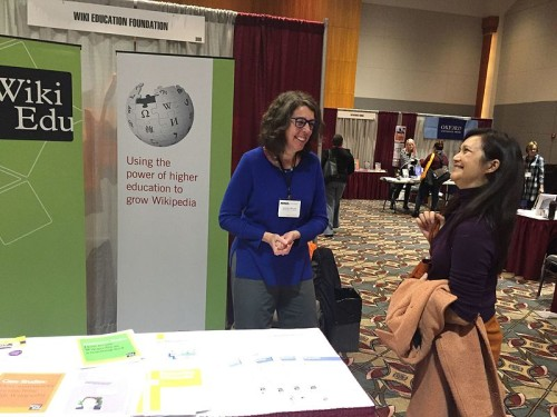 Longtime Wiki Ed participant Jenny Mikulay talks with first time instructor Linh Hua at the Wiki Education Foundation booth at NWSA.