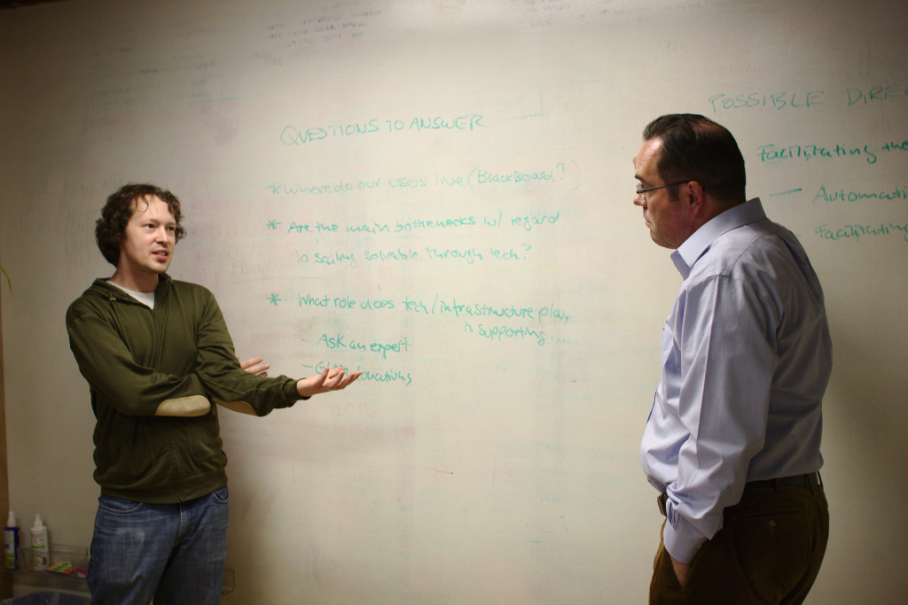 Sage Ross and Frank Schulenburg discuss future tech projects at a planning sprint at WINTR offices in Seattle.