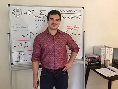 Nick Geiser in front of a white board